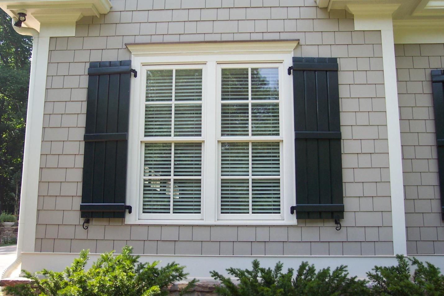Exterior shutters add value and increase the appeal of for House front window design