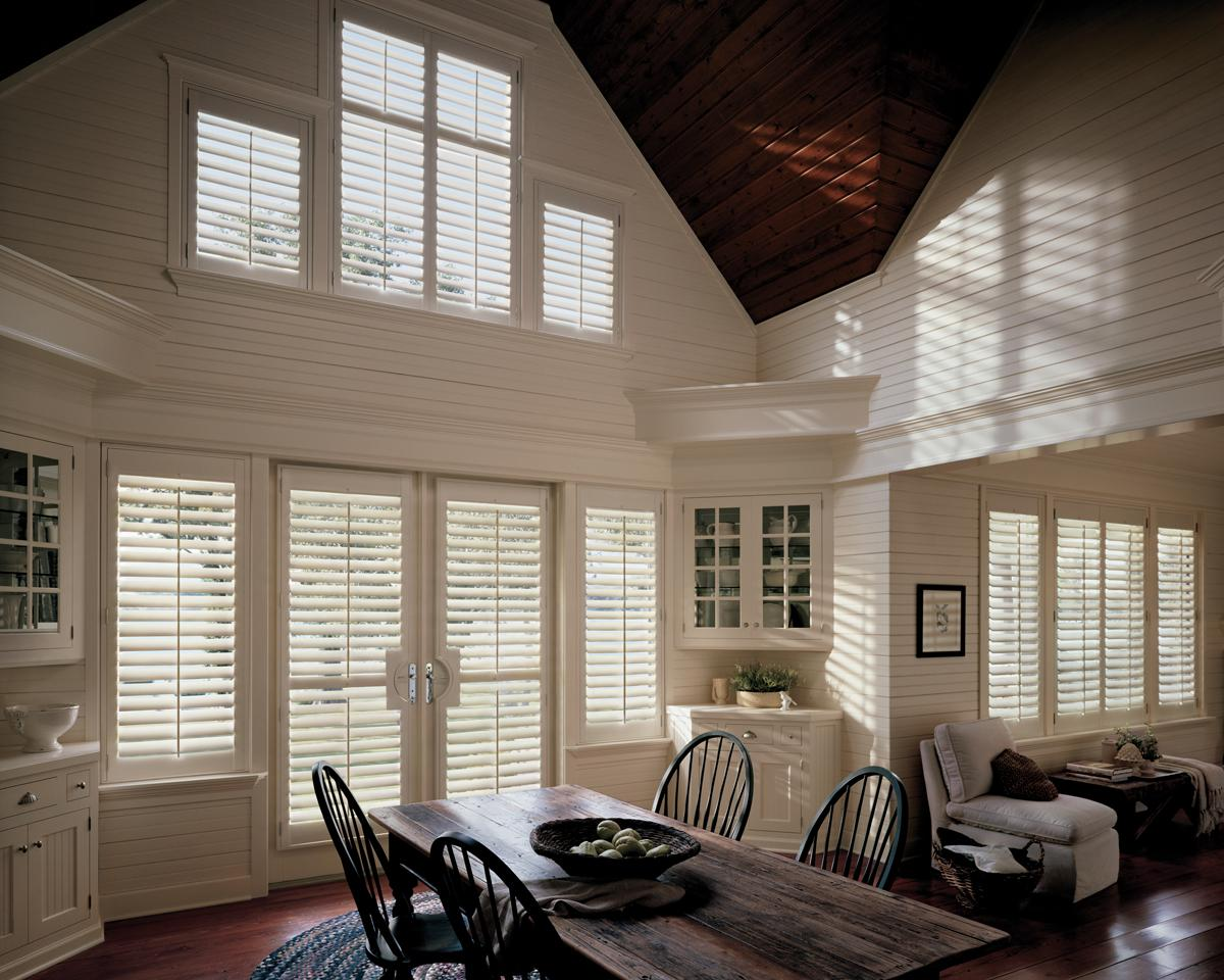 Custom plantation shutters for odd-shaped windows