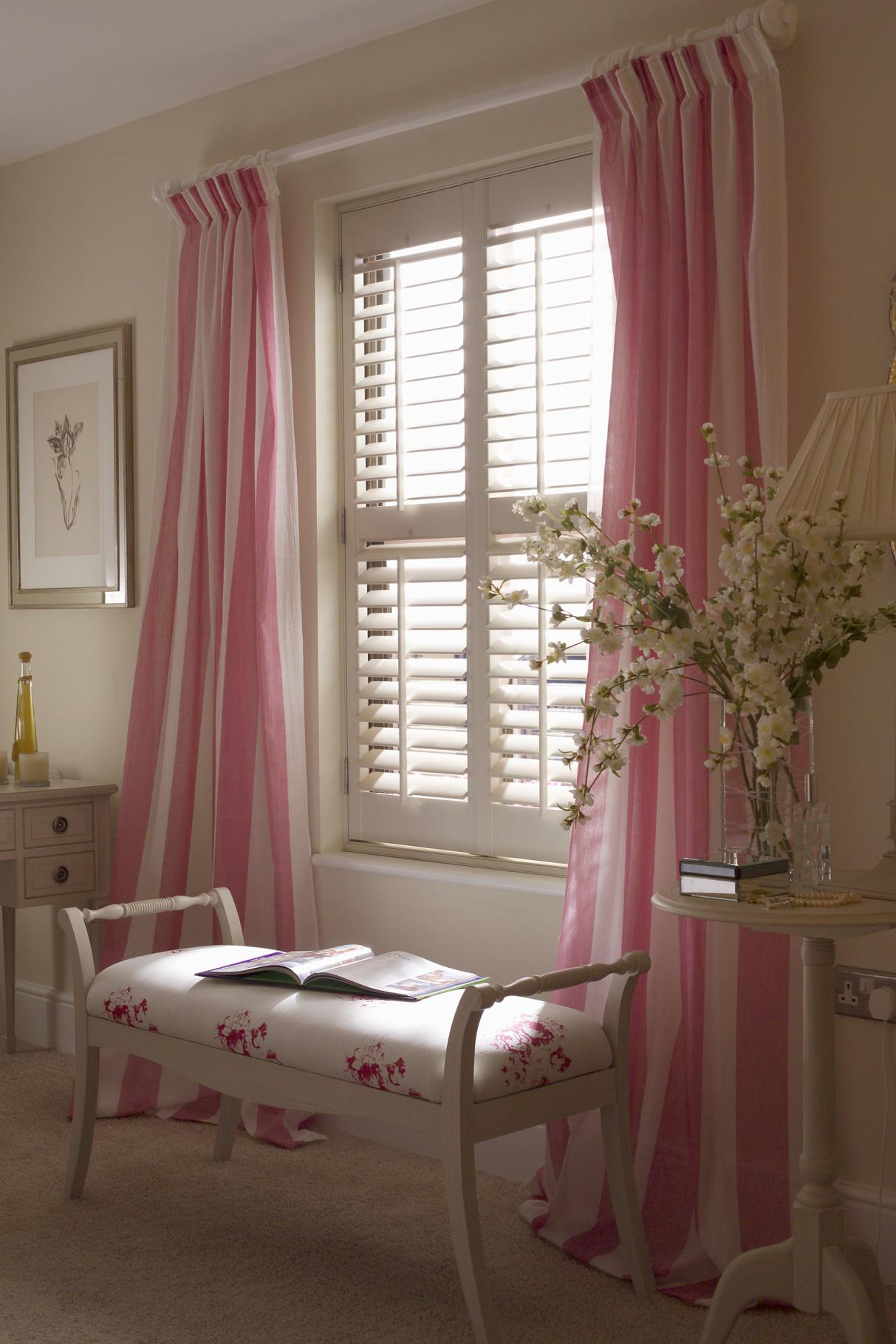Combining plantation shutters with drapes